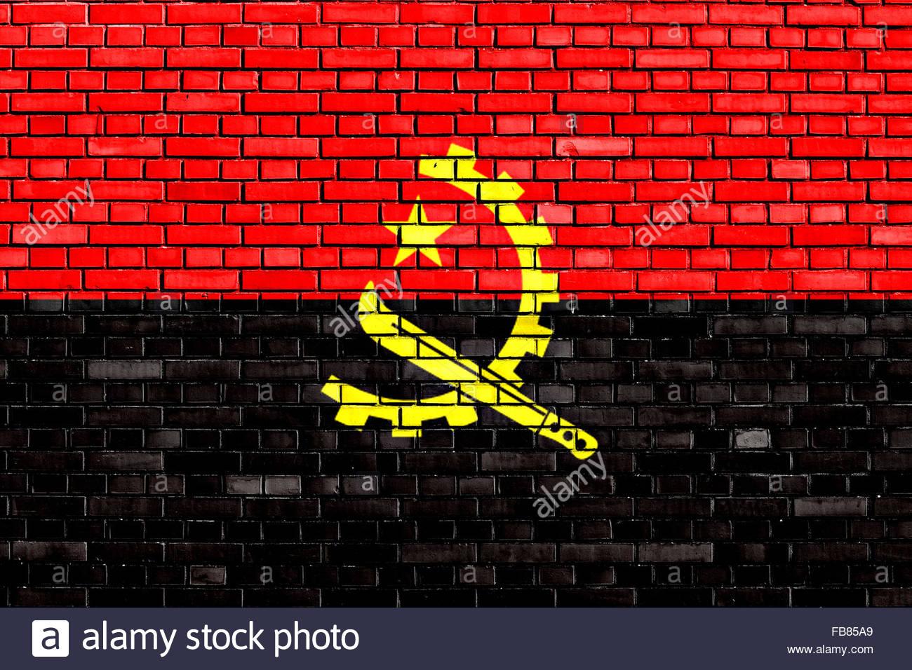 Drapeau de l'Angola a peint sur mur de brique Banque D'Images