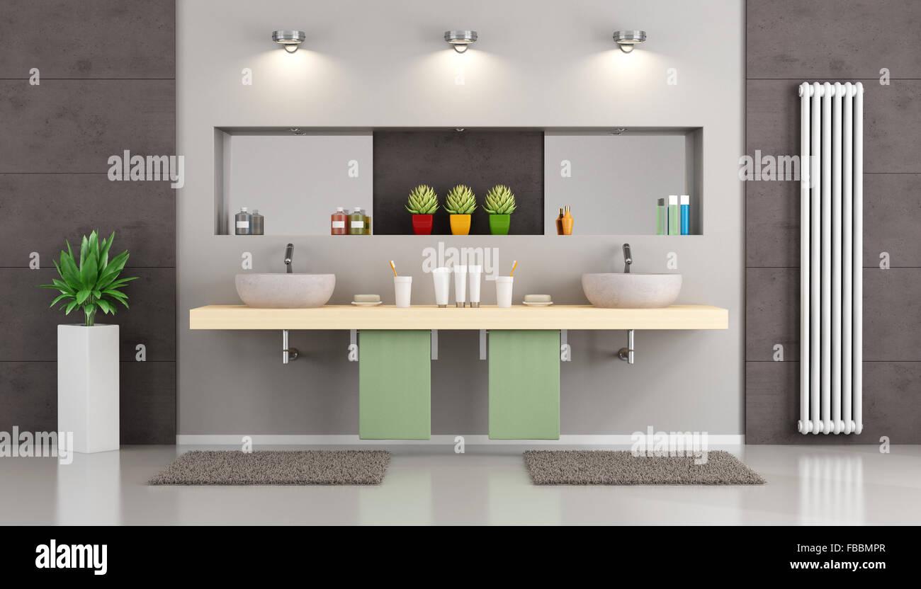Salle de bains moderne avec lavabo double, niche avec miroir et ...