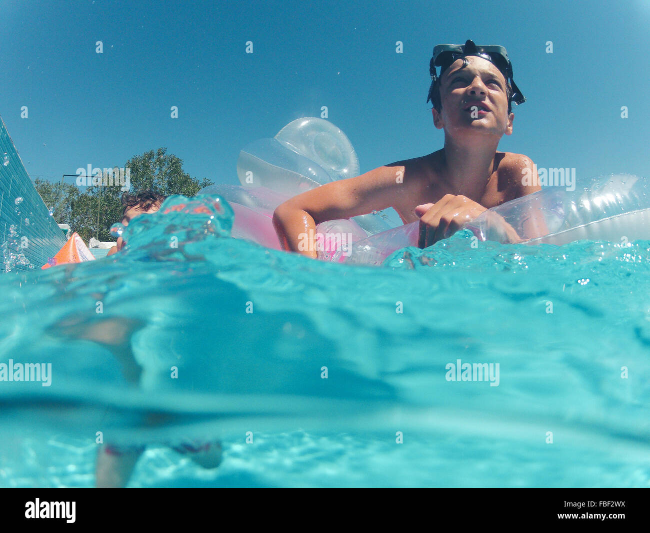 Low Angle View Of Boy Swimming In Pool Photo Stock