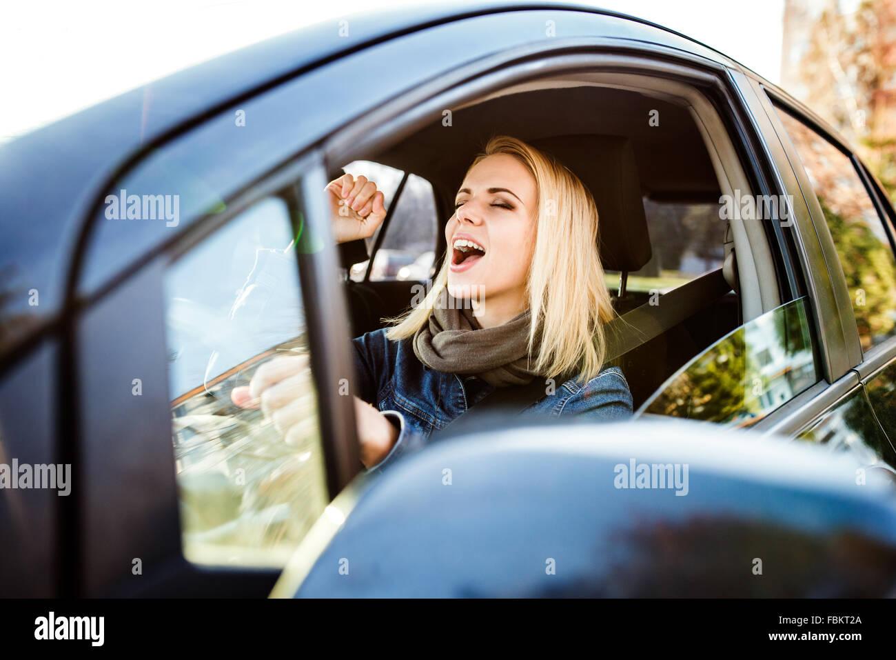 Woman driving a car Photo Stock