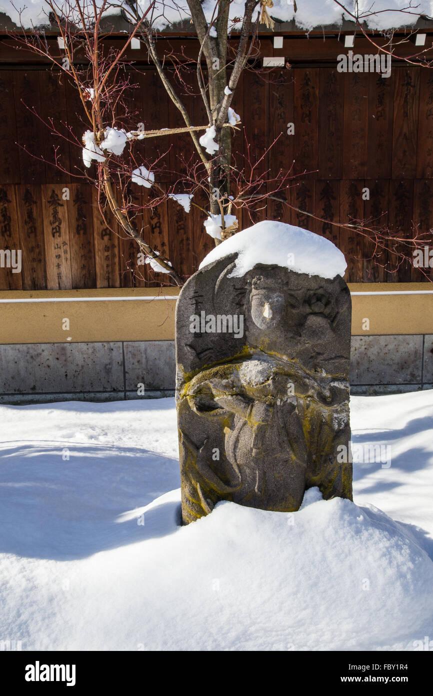 Dans la neige Jizo Jizo' - 'images et statues sont populaires au Japon comme Bodhisattva qui êtres Photo Stock