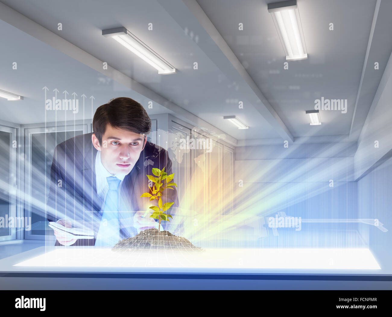 Young businessman looking at high-tech du sprig Photo Stock