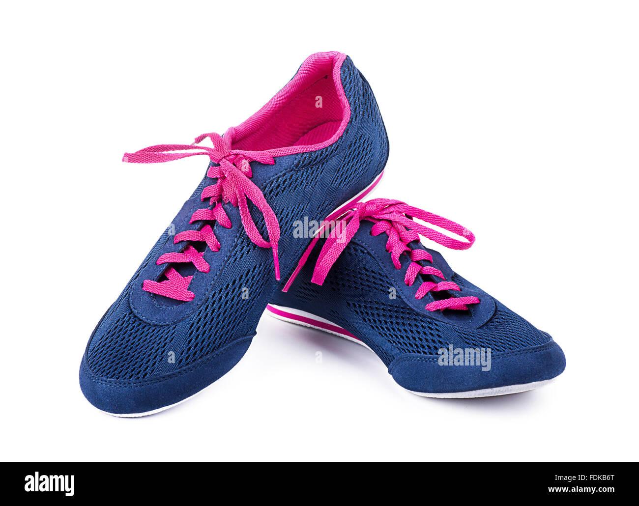 Les chaussures de sport sur un fond blanc Photo Stock