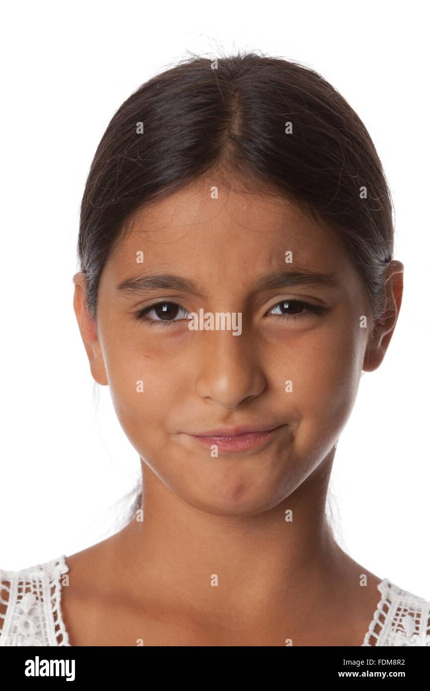 Jeune adolescente avec le doute, portrait sur fond blanc Photo Stock