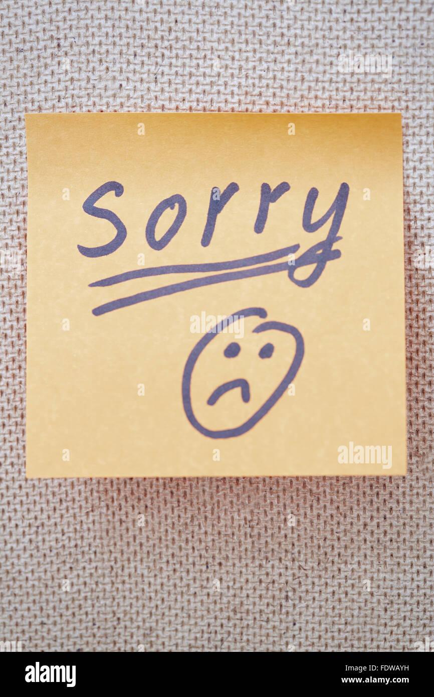 Images avec texte désolé et triste smiley sur une étiquette Photo Stock