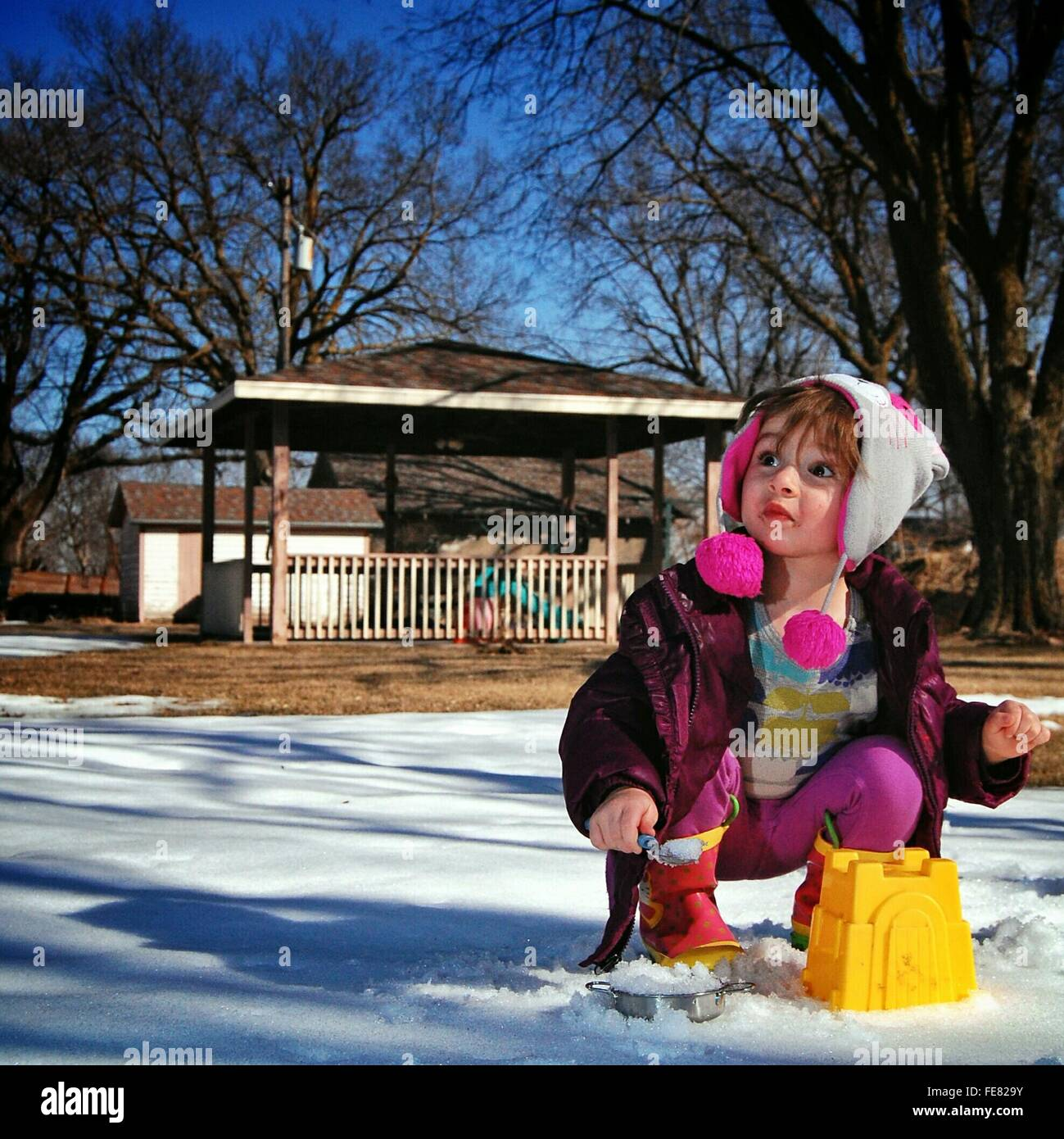 Cute Little Girl Playing in snow Photo Stock