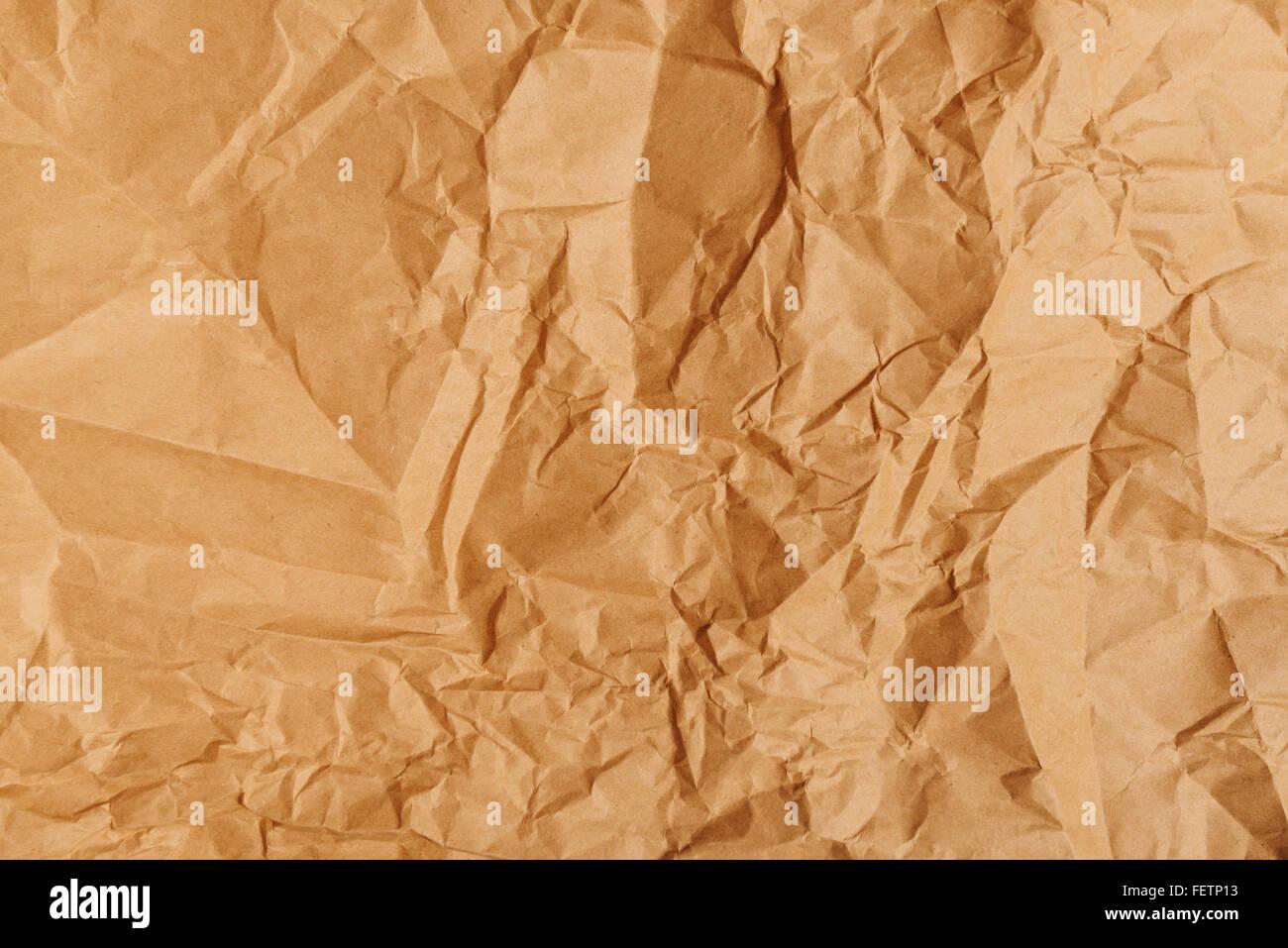 Plié et froissé papier kraft pour la texture, l'arrière-plan de la vue supérieure du châssis Photo Stock
