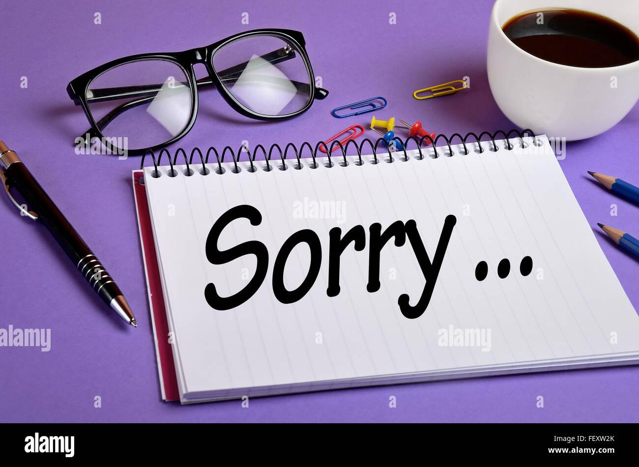 Désolés mot écrit sur le bloc-notes Photo Stock