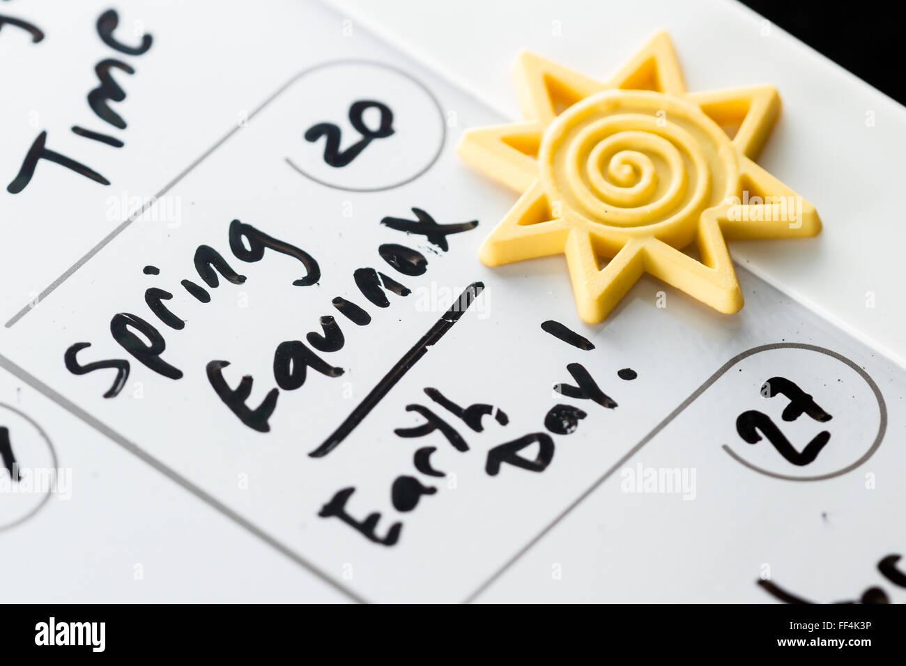 20 mars marqué sur un calendrier que l'équinoxe du printemps et aussi la Journée de la Terre Photo Stock