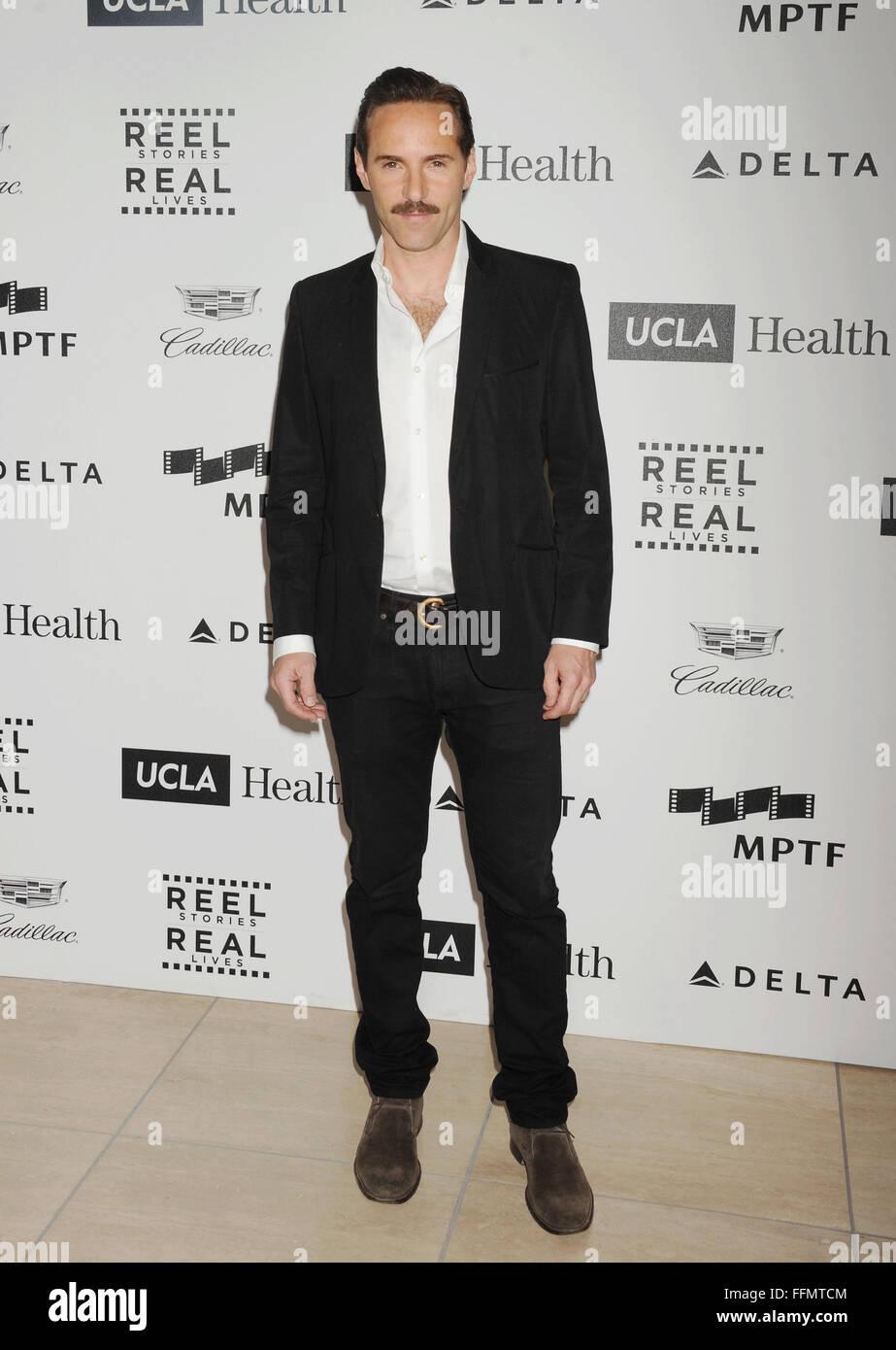 L'acteur Alessandro Nivola arrive à la 4e édition des Histoires du tambour, du vrai vit cas bénéficiant Photo Stock