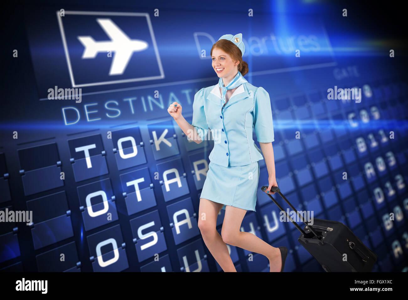 Image composite de jolie hôtesse de l'air, pulling suitcase Photo Stock