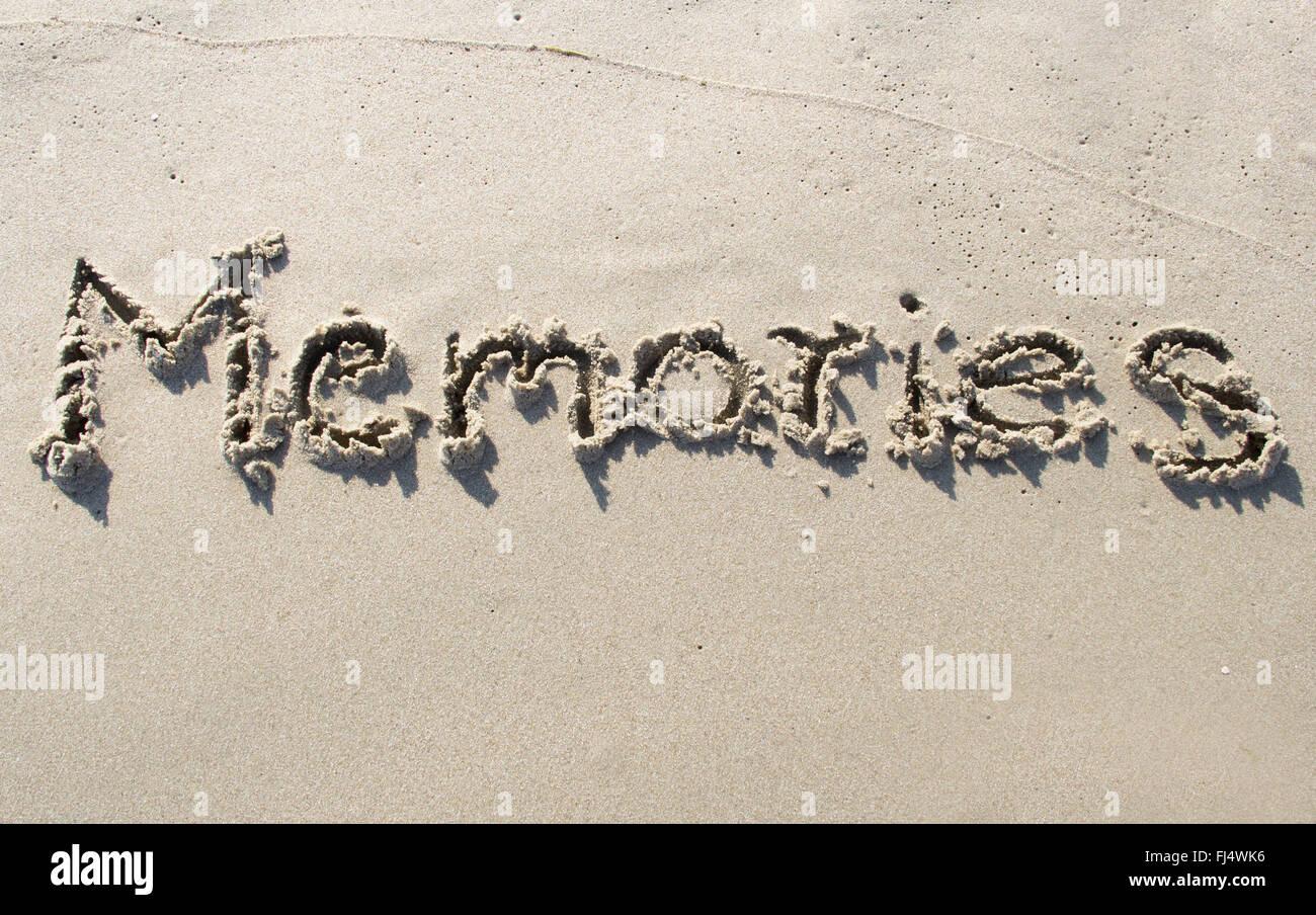 'Mémoires' écrit sur la plage de sable Photo Stock