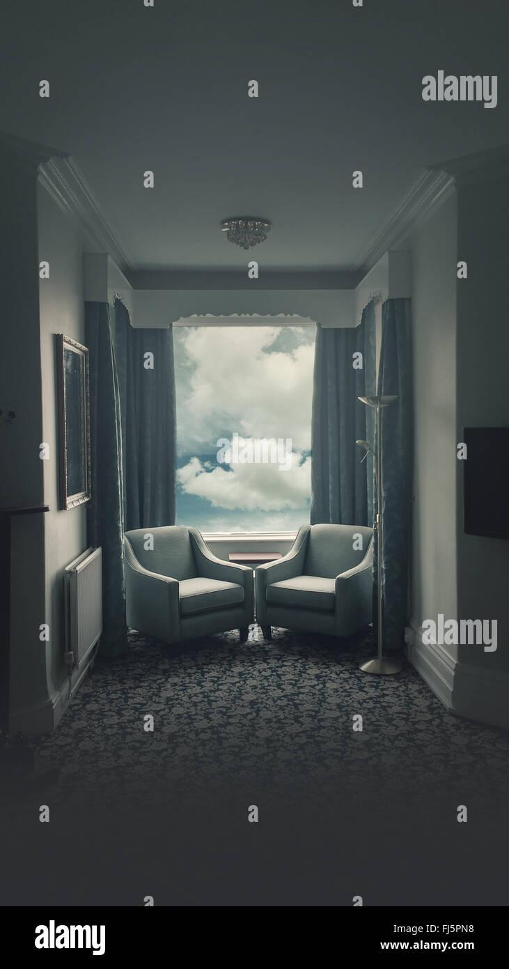 La chambre d'hôtel avec deux fauteuils face à face Photo Stock