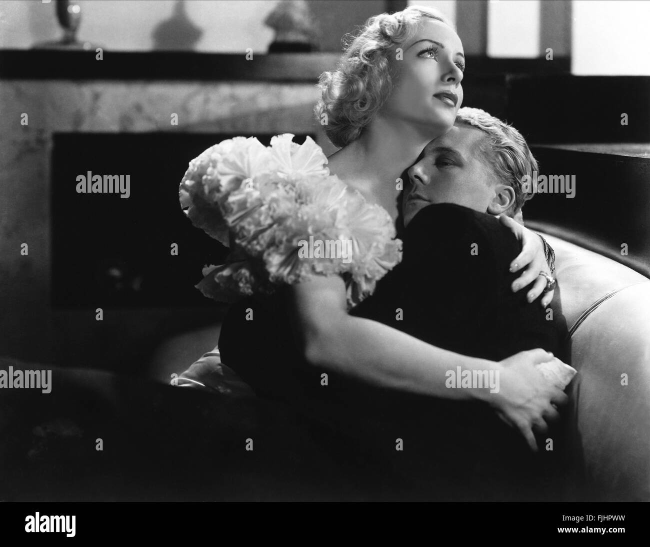 GENE RAYMOND, Carole Lombard, bref moment, 1933 Banque D'Images