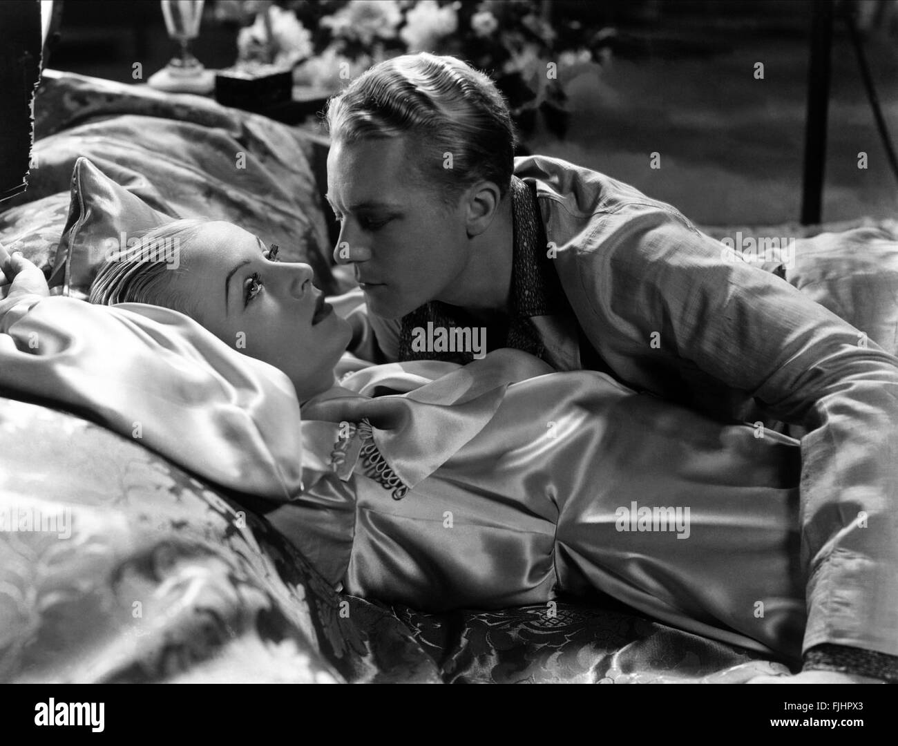 CAROLE LOMBARD, GENE RAYMOND, bref moment, 1933 Banque D'Images