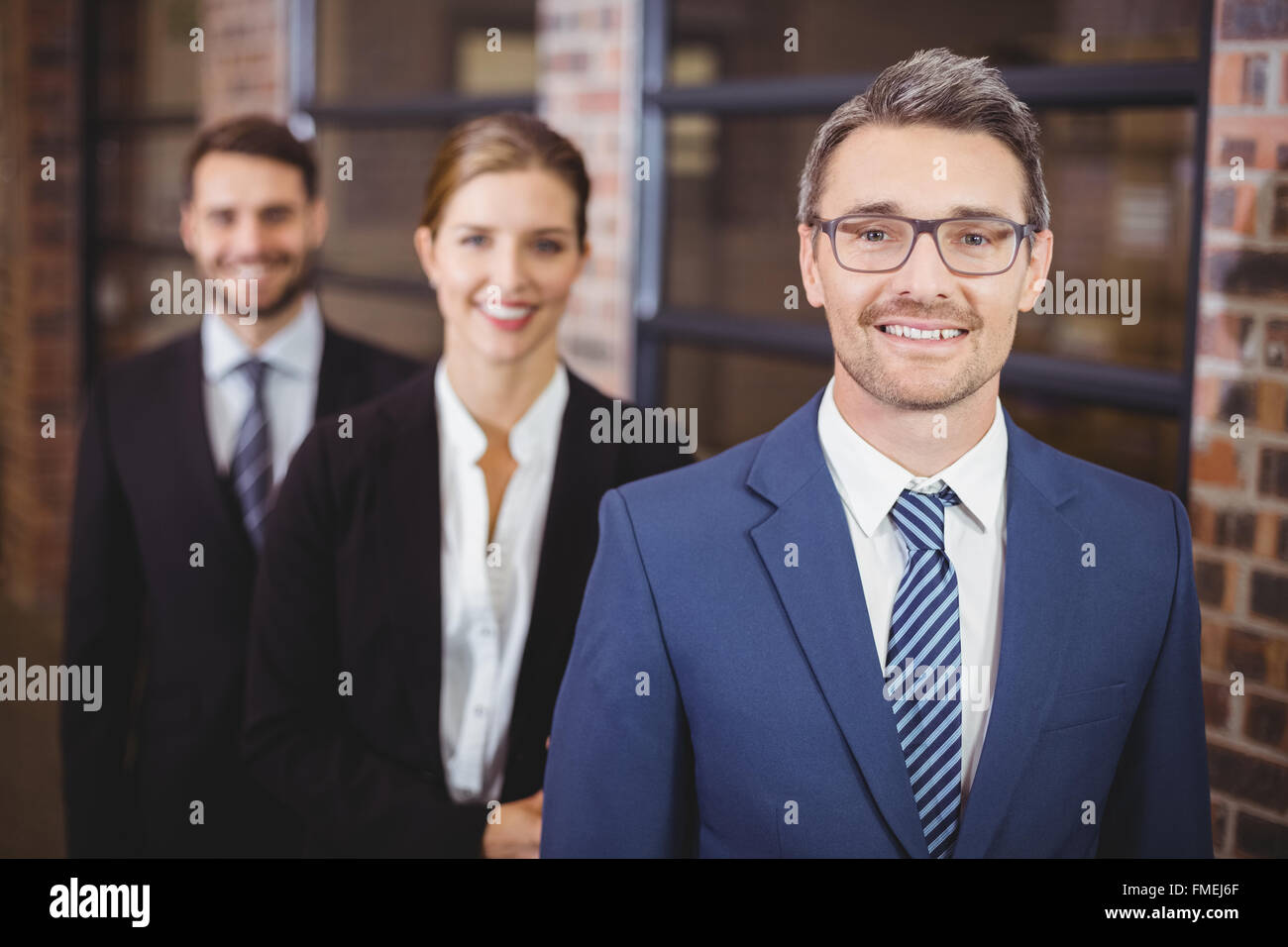 Happy business people standing in row Photo Stock