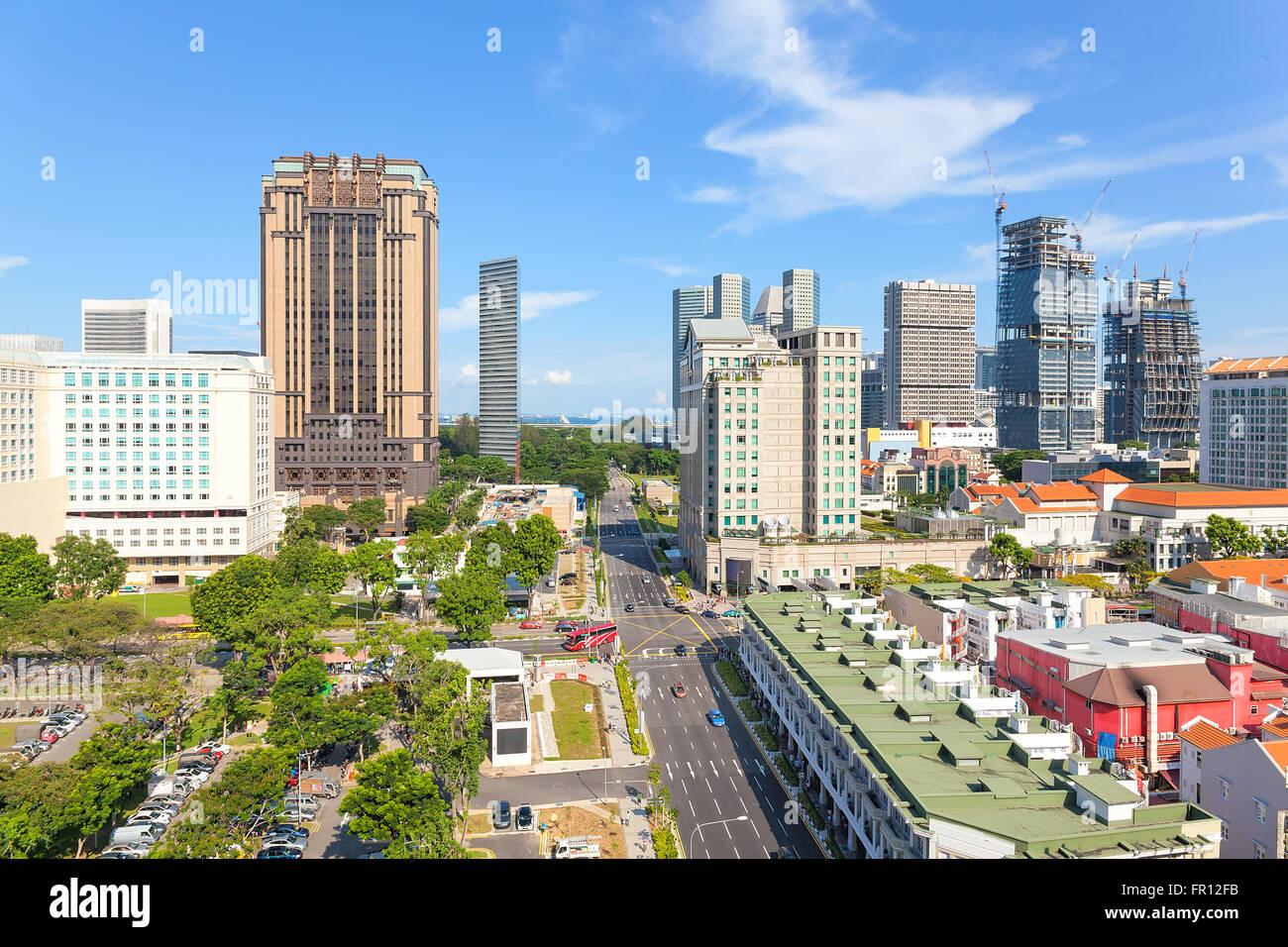 Construction de gratte-ciel au quartier commerçant de Bugis Streety de jour à Singapour Banque D'Images