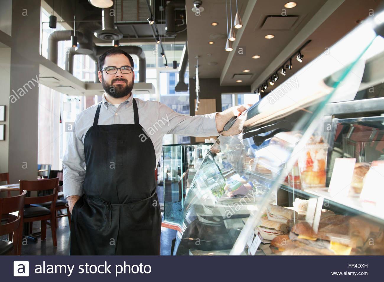 Propriétaire d'une boutique de café Photo Stock