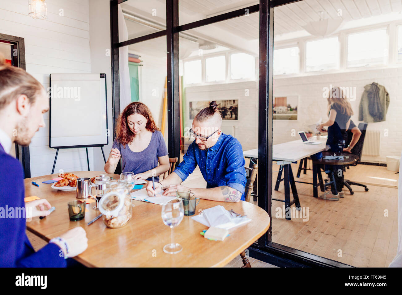 Creative business people working at table in background Photo Stock