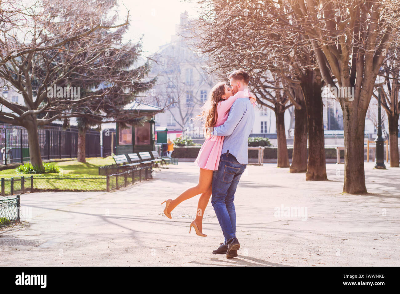 Dating, happy young girl hugging her boyfriend Photo Stock