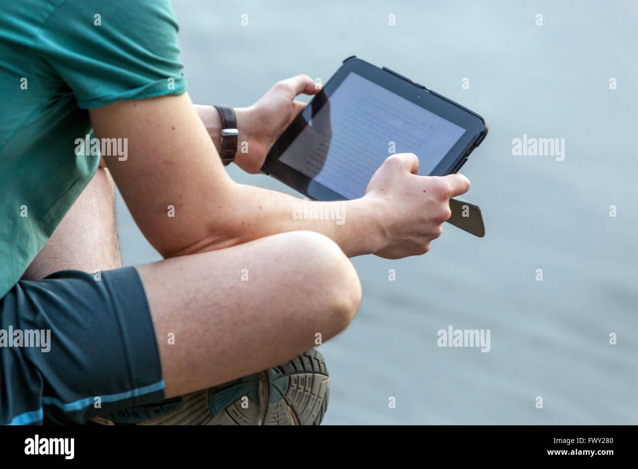 Man looking at digital tablet Photo Stock