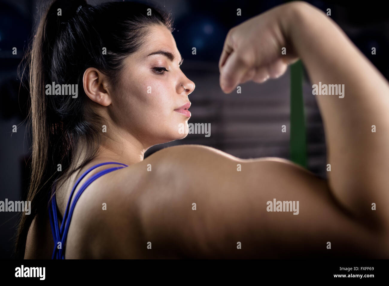 Woman flexing muscles Photo Stock