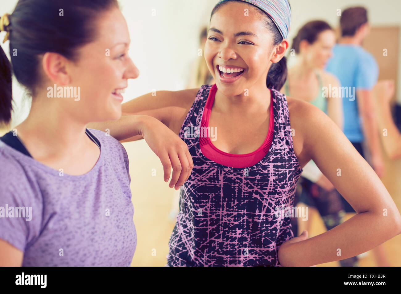 Laughing women in exercise class Photo Stock