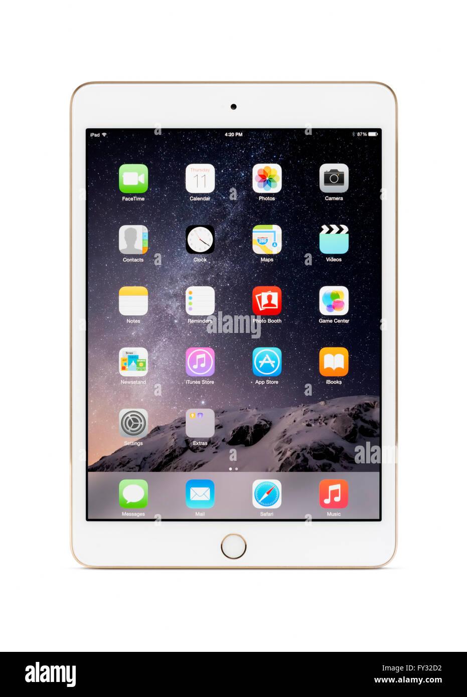 L'or blanc Apple iPad Mini tablette 3 ordinateur avec des icônes du bureau sur son écran Photo Stock