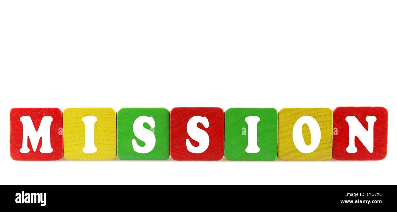 Mission - texte isolé en blocs de construction en bois Photo Stock