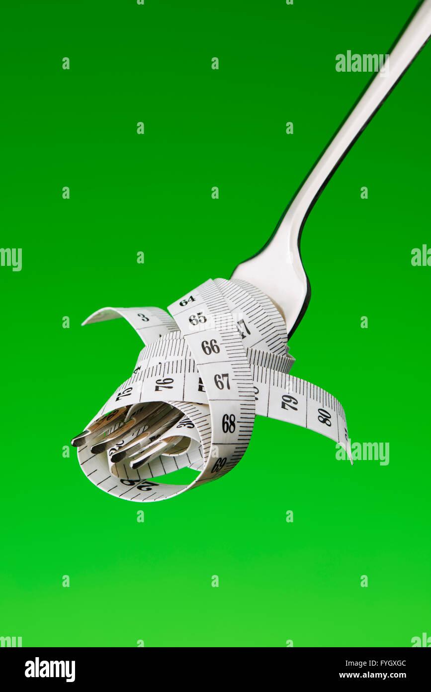Fourche avec ruban de mesure suivant un régime Obésité Concept Photo Stock
