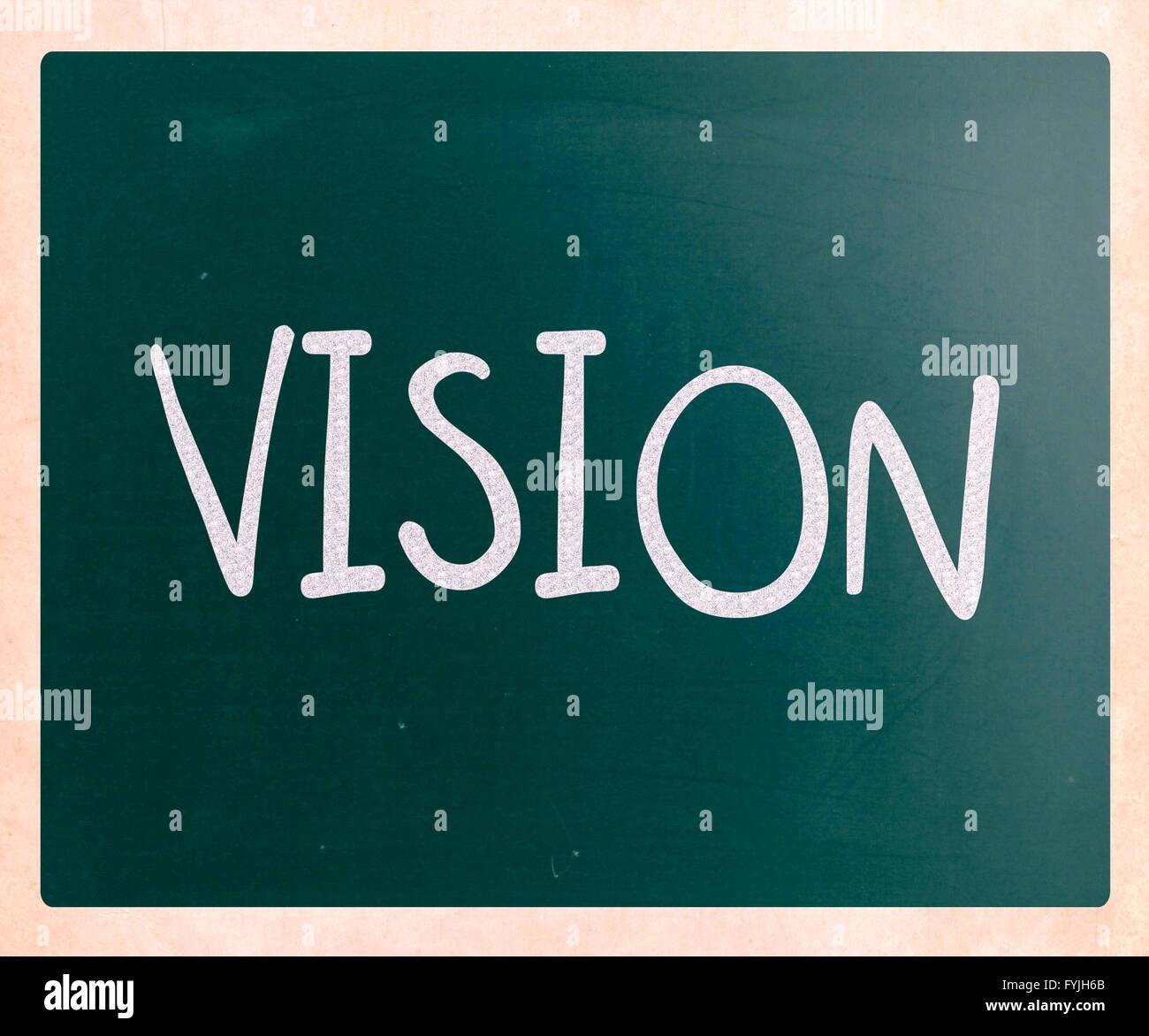 Manuscrite Vision avec craie blanche sur un tableau noir Photo Stock