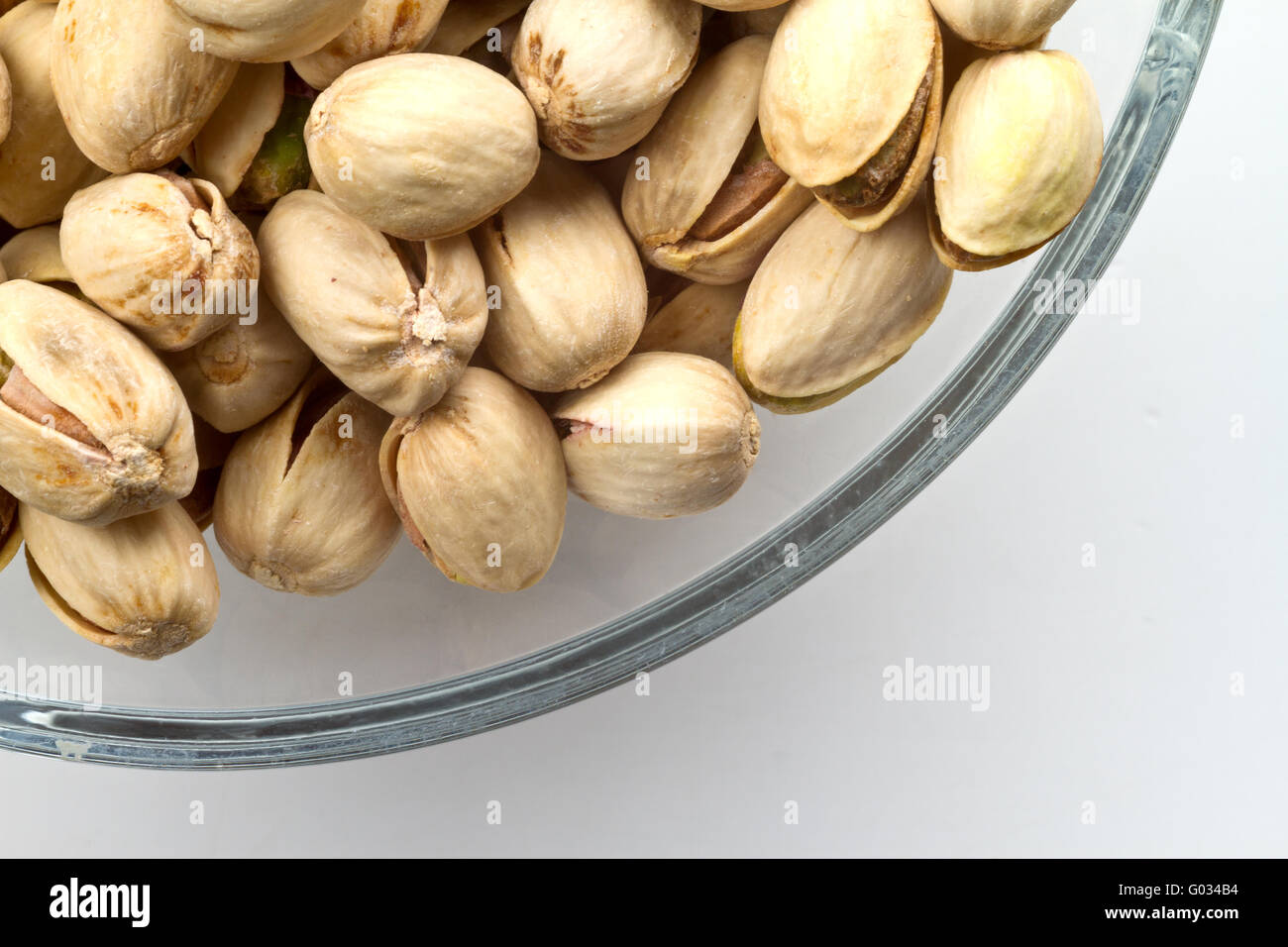 Bol en verre de pistaches Photo Stock