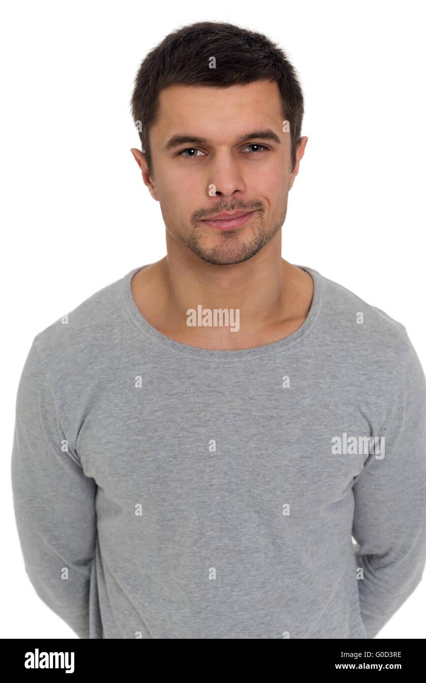 Portrait d'un jeune homme avec un sourire malicieux Photo Stock