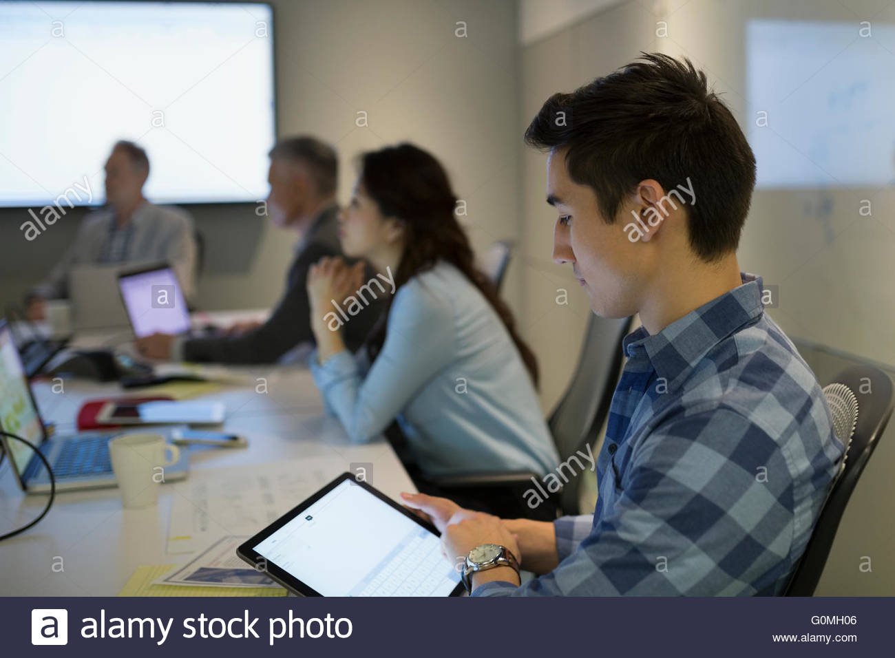 Businessman using digital tablet in conference room meeting Photo Stock