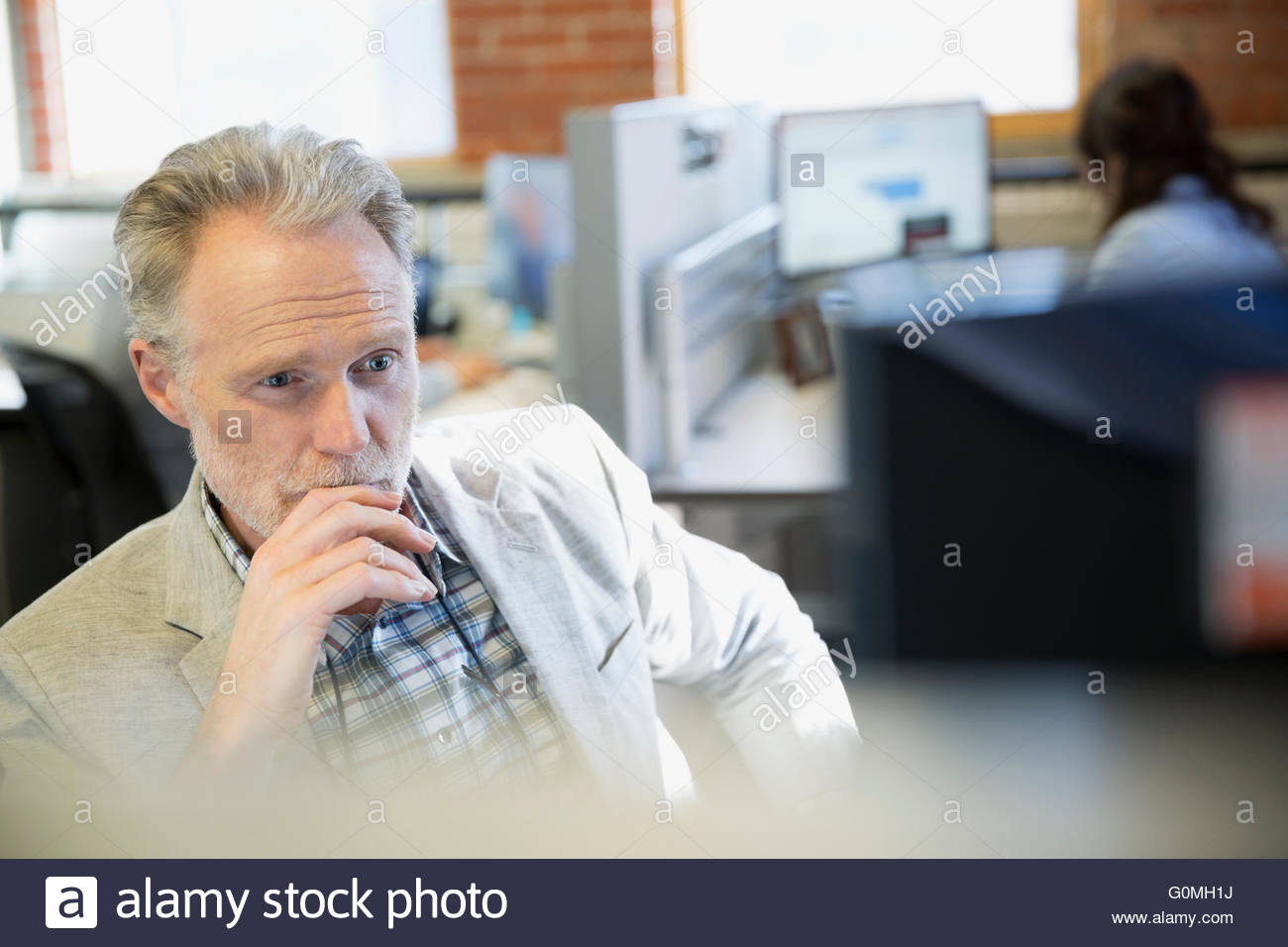 Serious businessman using computer in office Photo Stock
