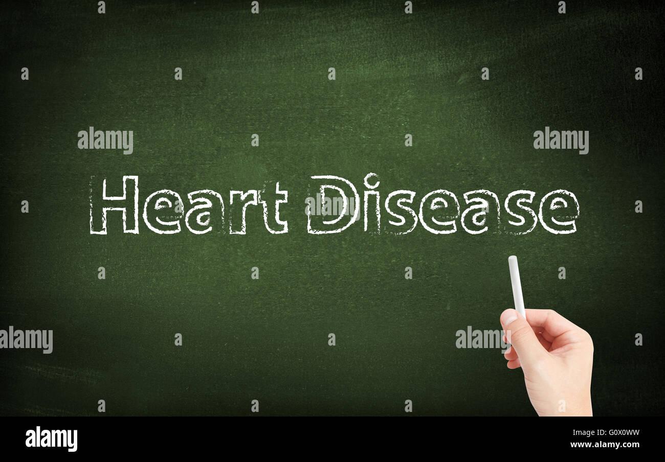 La maladie de coeur écrit sur un tableau noir Photo Stock