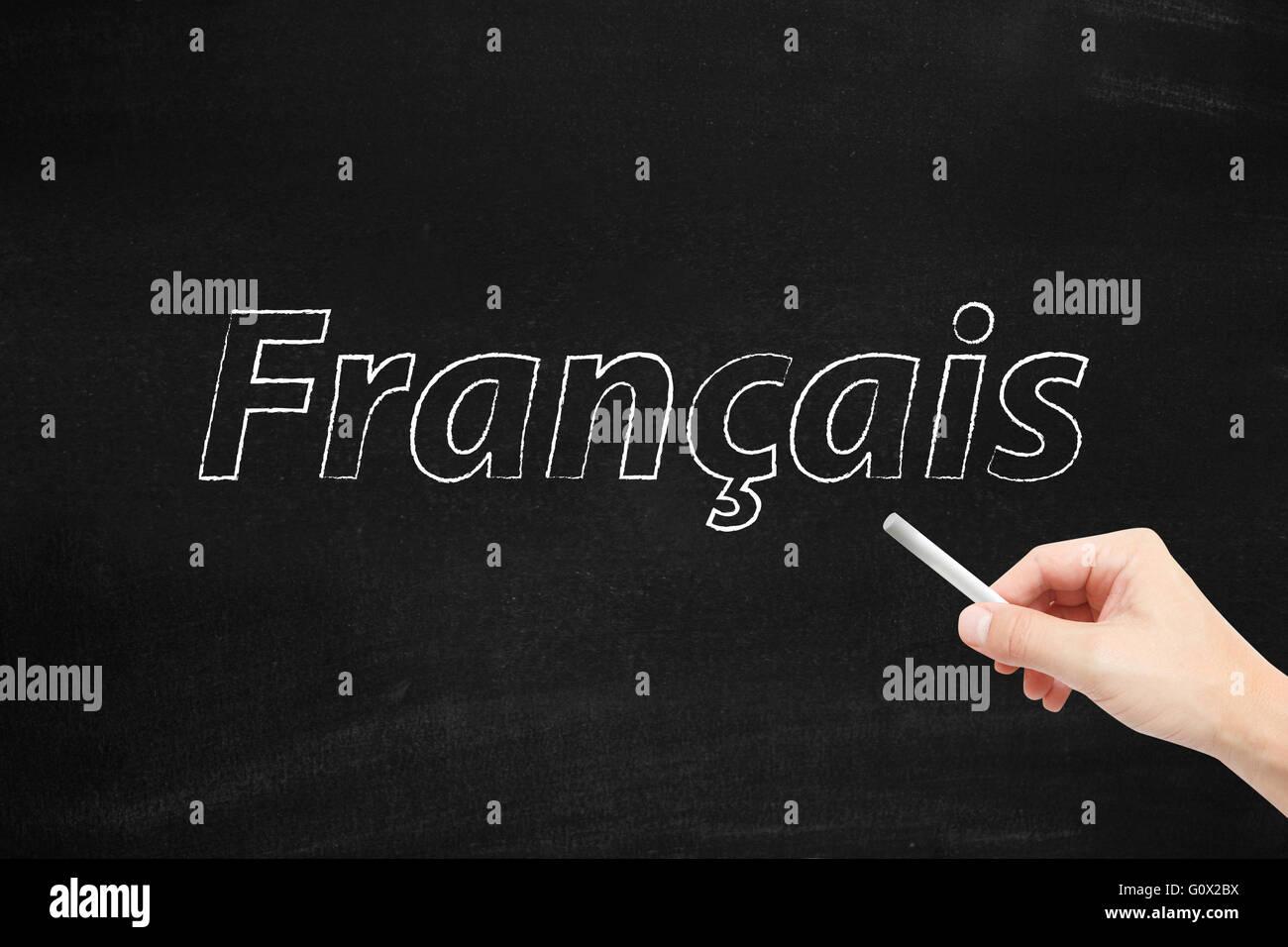La langue de France, Francais, écrit sur un tableau noir Photo Stock