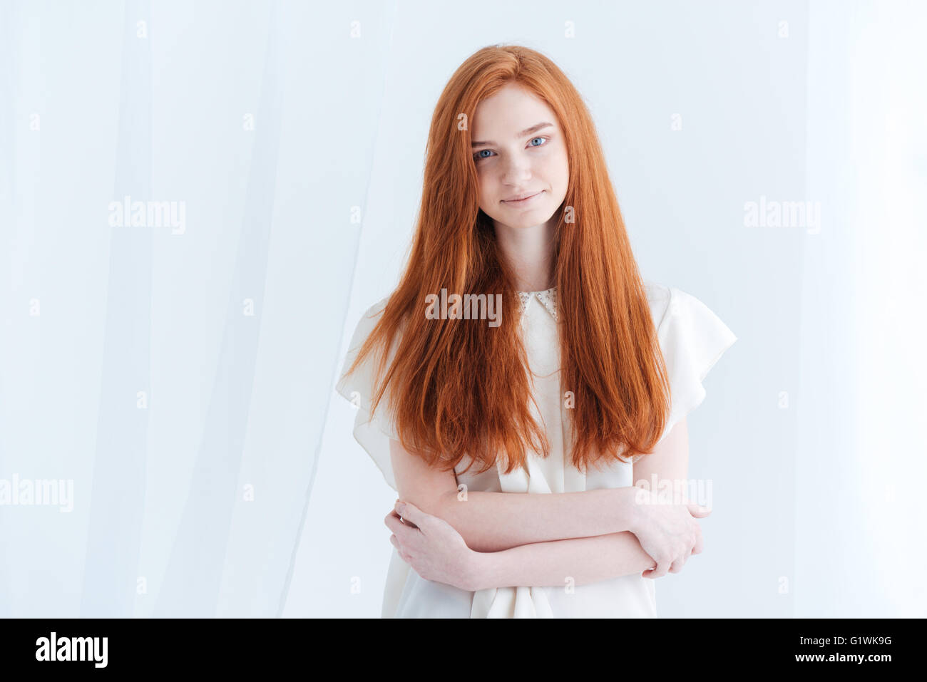 For redhead woman posing tempting