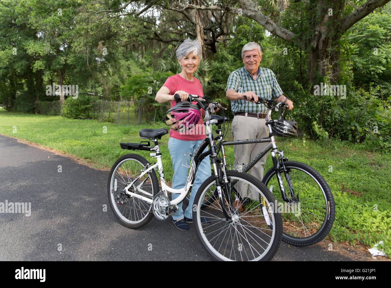 Senior couple riding bicycles Photo Stock