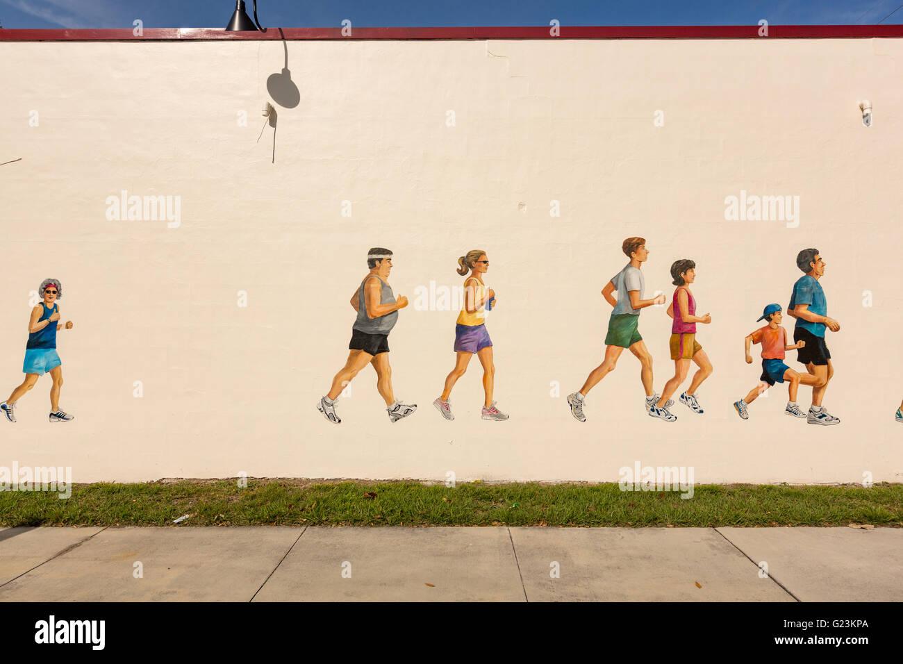 Photo murale peinte de coureurs à suivre Shack magasin de sport dans le quartier branché d'Colonialtown Photo Stock