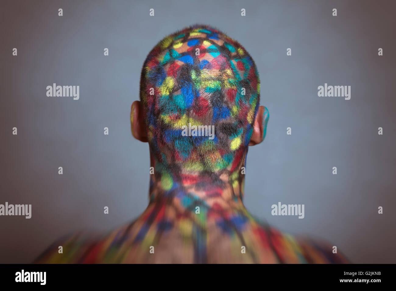 Vue arrière du super-héros, l'art de corps colorés avec Tilt Shift et effet de flou. Photo Stock