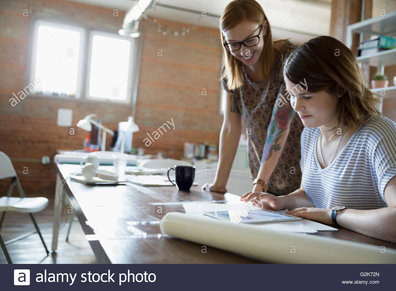 Designers using digital tablet in office Photo Stock