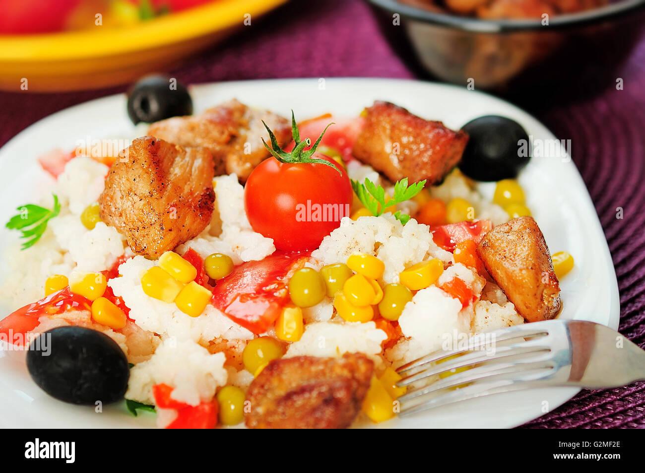 La plaque avec le risotto et de la viande Photo Stock