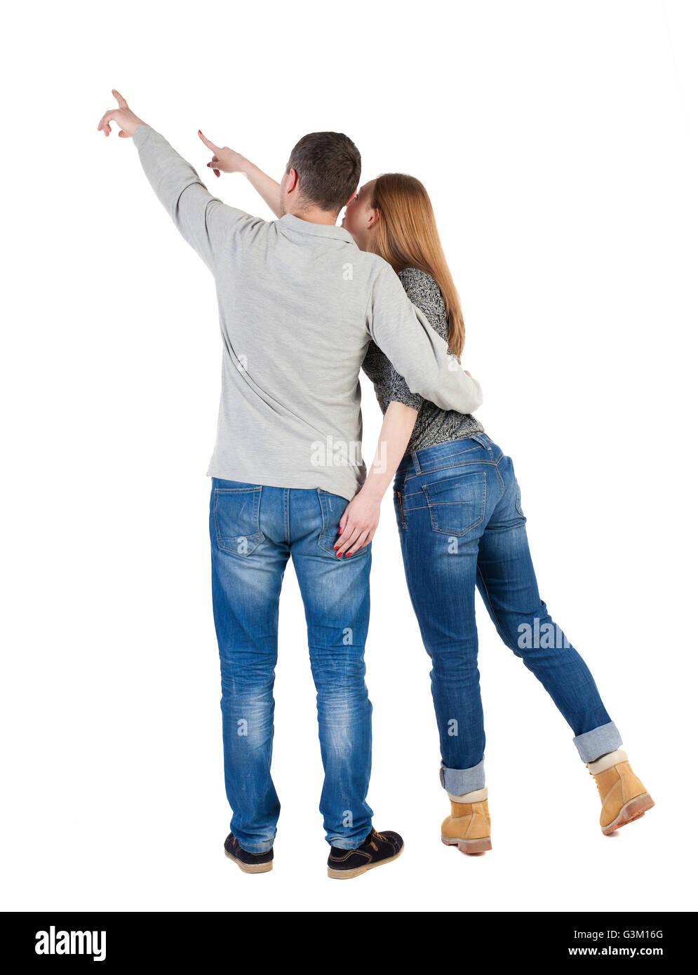 Jeune couple pointing at wal vue arrière (femme et homme