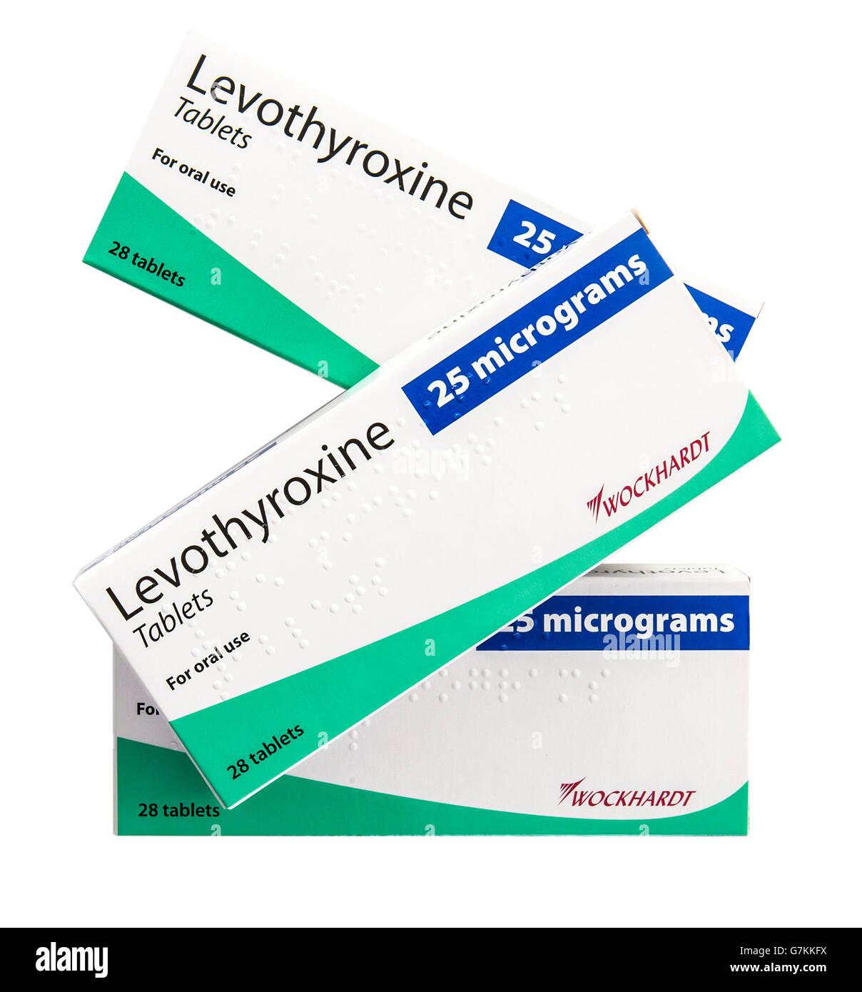 Trois boîtes de 25 microgrammes comprimés de lévothyroxine utilisée comme médicament pour Photo Stock