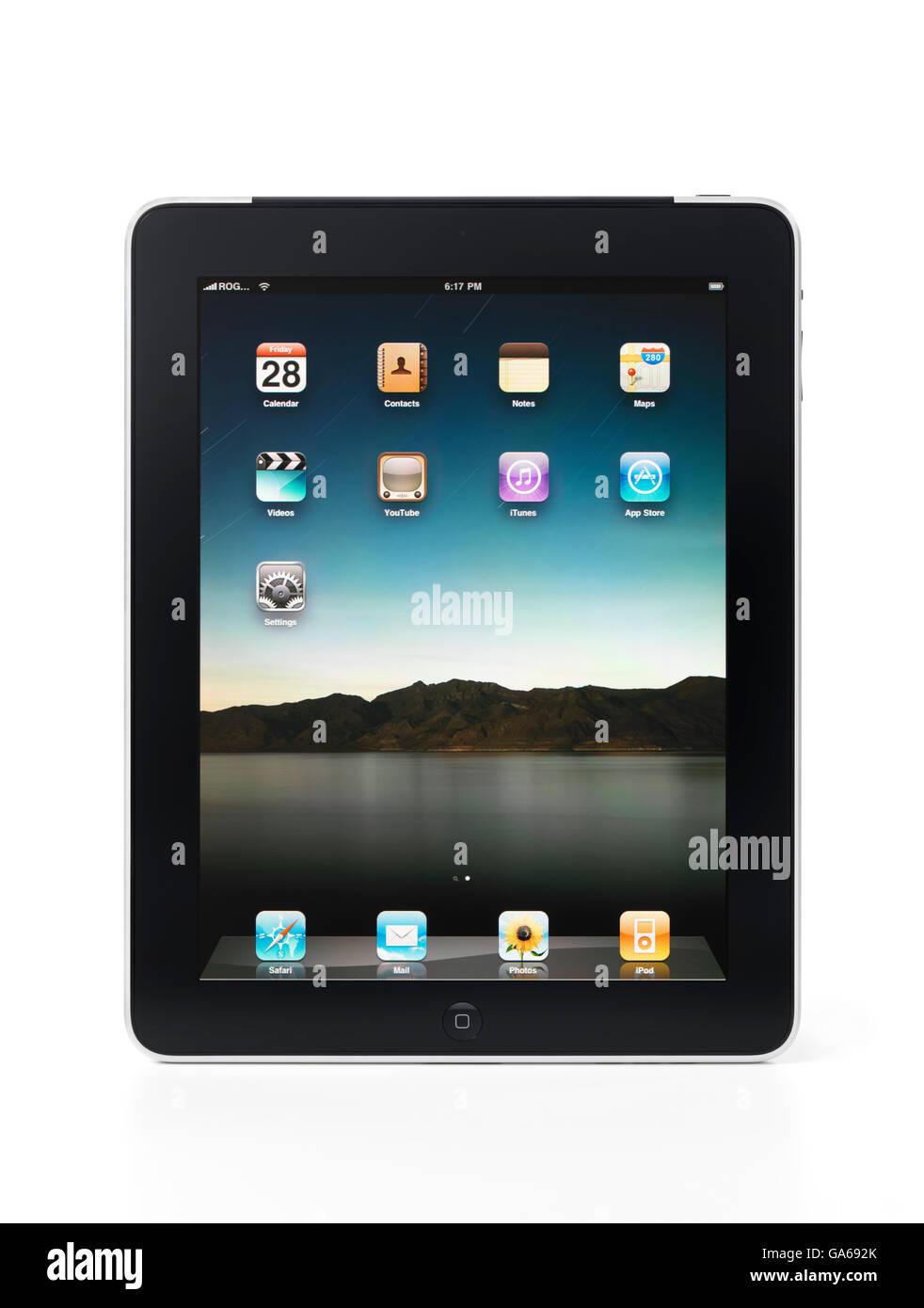 Tablette Apple iPad 3G avec des icônes du bureau sur son écran Photo Stock
