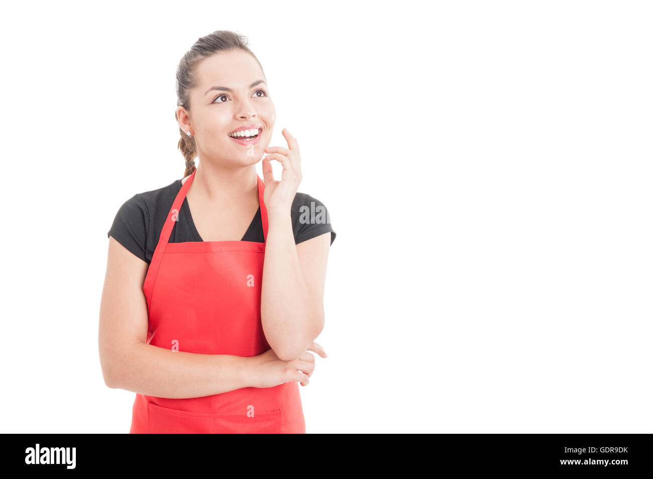 Belle femme avec un tablier de travail ayant une grande idée et joyeux sourire onn isolé blanc avec copyspace Photo Stock