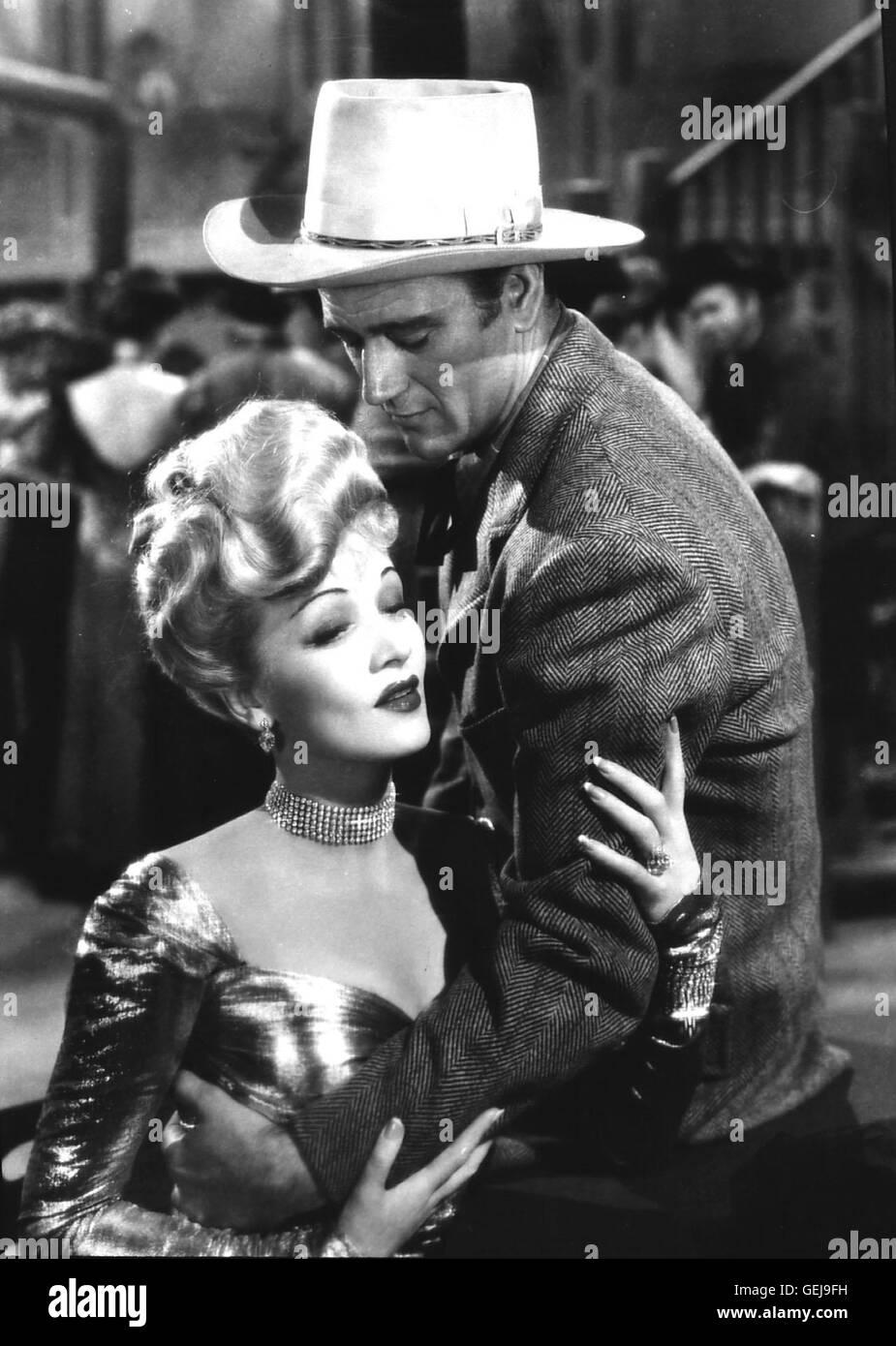 John Wayne, Marlene Dietrich Goldgraeber Roy Glennister (John Wayne) muss um die Rechte un senneur Goldmine vor Gericht kaempfen. Dabei wird er und schliesslich hintergangen Gefaengnis landet im. Cherry Malotte Bardame (Marlene Dietrich) ihm helfen. * Banque D'Images