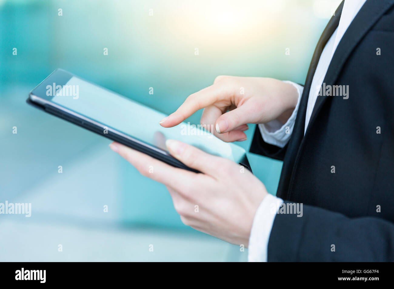 Businesswoman using a digital tablet Photo Stock