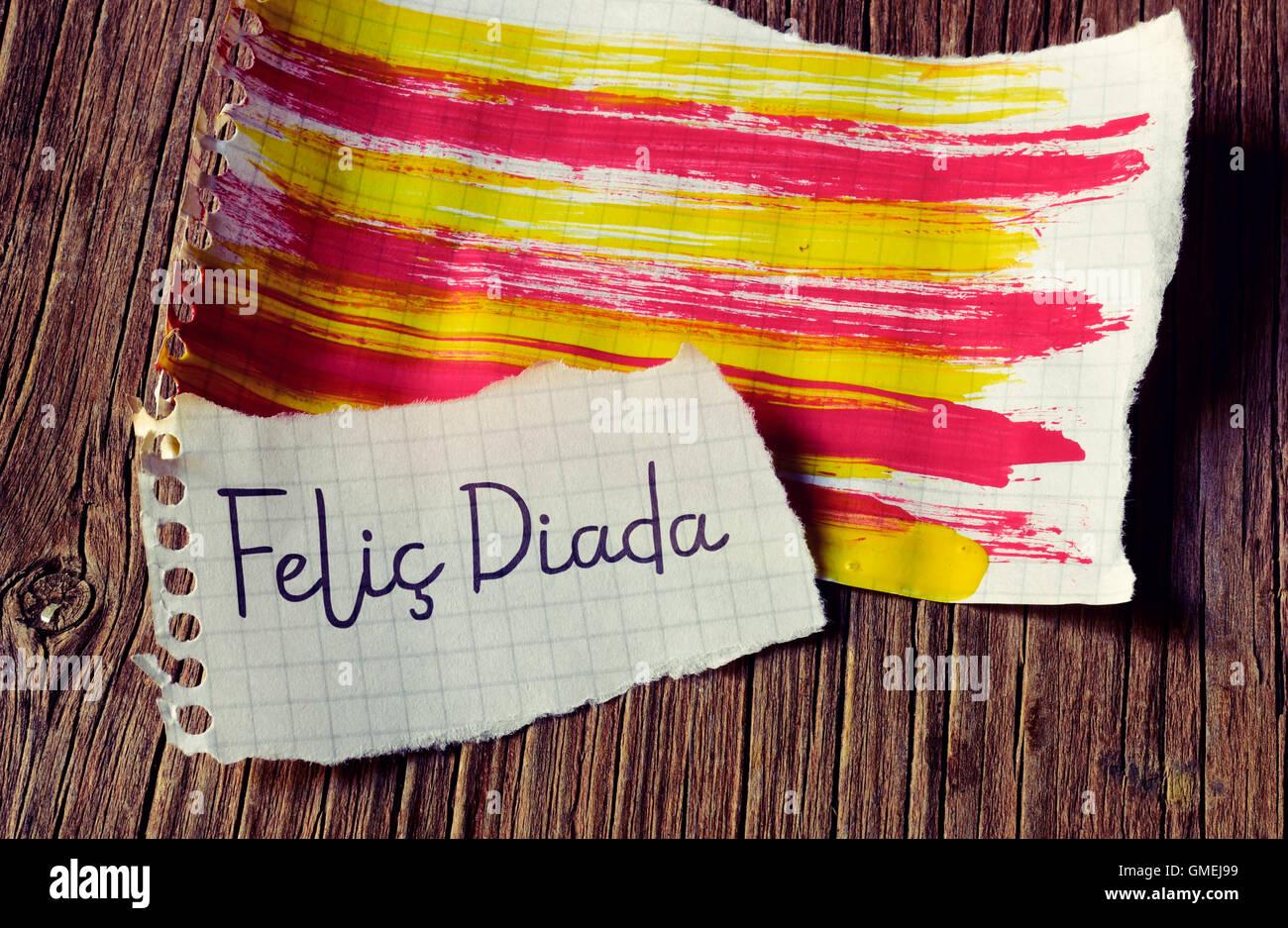 Le texte Felic Diada, heureux de la Journée nationale de la Catalogne en Catalan écrit dans un morceau Photo Stock